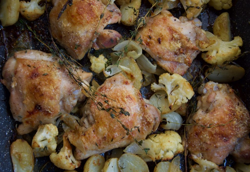 Parmesan roast chicken with cauliflower thyme kitchen on fourth in this recipe from diana henrys latest cookbook simple chicken thighs baby potatoes cauliflower florets and onion wedges are tossed with olive oil forumfinder Choice Image